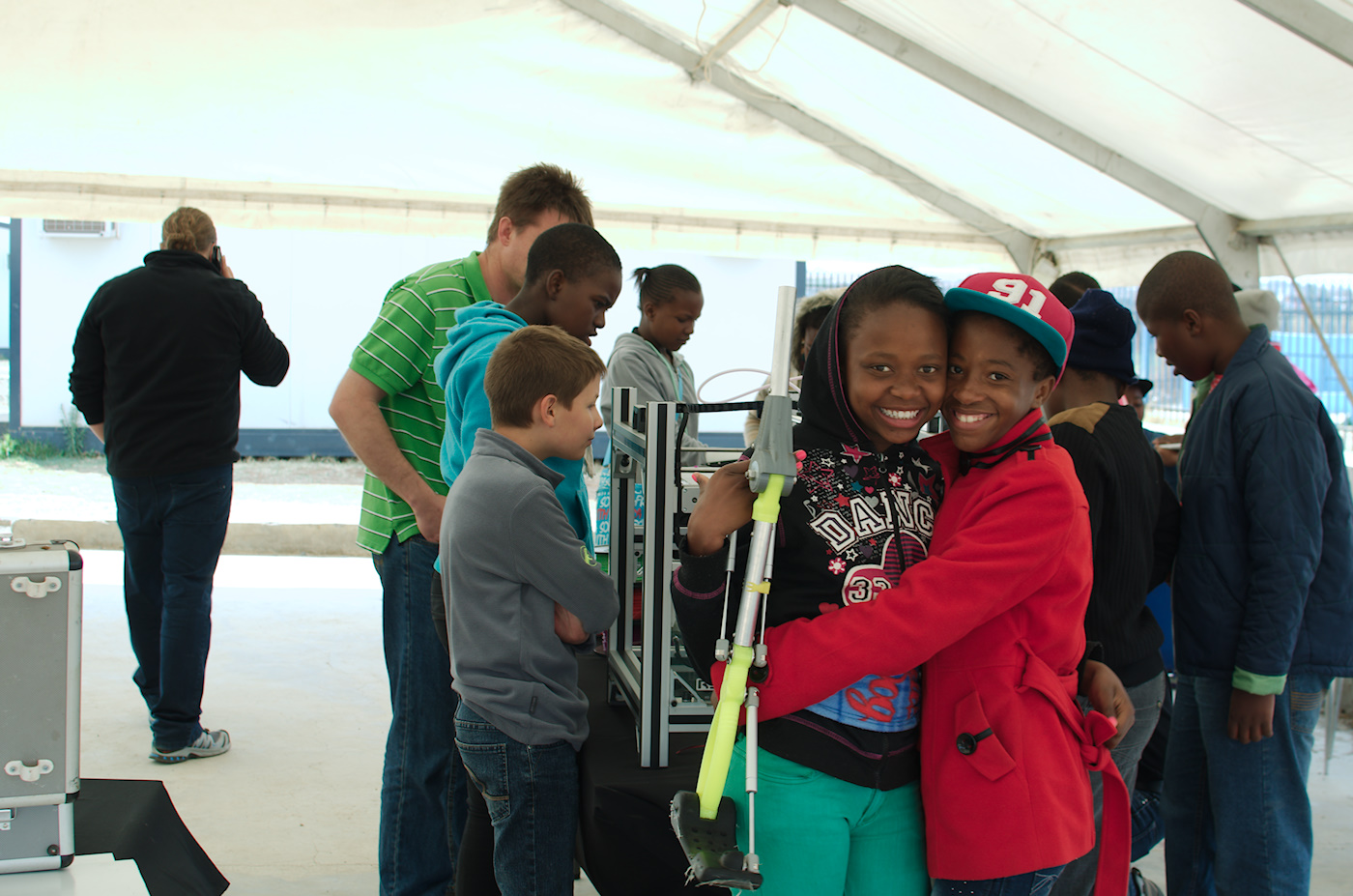 Kids posing with RoboLeg, another low cost prosthetic from Richard van As.
