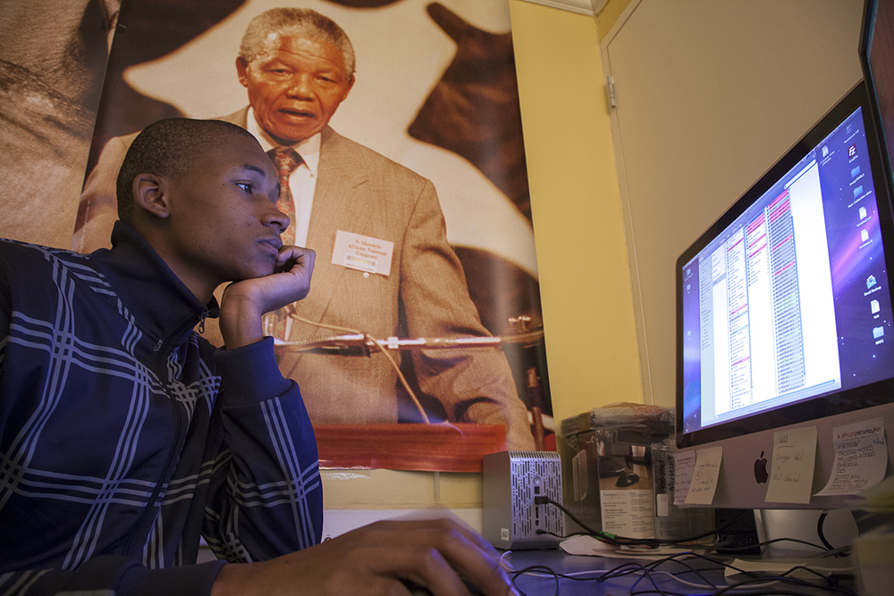 Sizwe Mnculwane, a photo retoucher at Africa Media Online working the African Image Pipeline project in 2009. Funded by the European Union through the Department of Economic Development in KZN, the project saw the digitisation of 24,000 images from over 30 master photographers and heritage instutions ahead of the 2010 Fifa World Cup in order that South Africa's history could be made available to publishers all over the world.