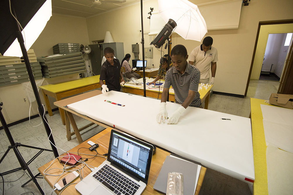 The Africa Media Online digitisation team digitising museum artifacts at the KwaZulu-Natal Museum Services in 2013. Africa Media Online works with many organisations including museums, archives, media organisations, media professionals, corporates and NGOs to enable them to get their valuable media collections to whatever audience they want to reach.
