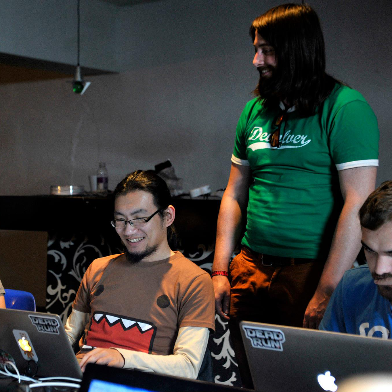 A MAZE 2014, Tu doing a game jam with the theme Shongololo. Evan Greenwood of Free Lives (standing), Loet Jansen Van Rensburg, Twoplus Games (sitting)