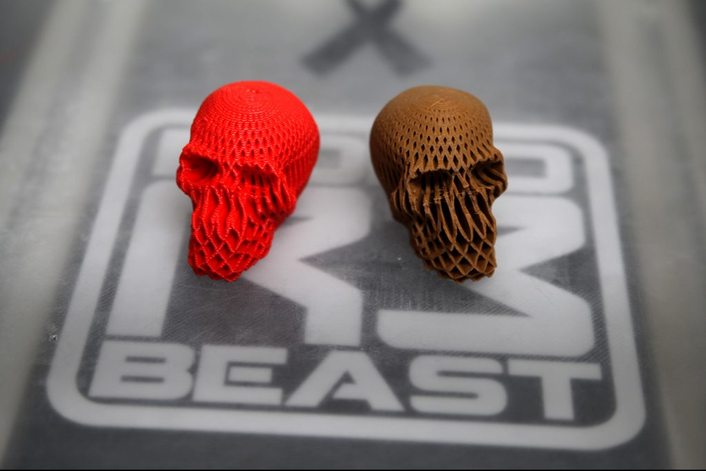 (Right) the red skull took a fraction of the time to print when compared to the brown one (left). Can you tell the difference?