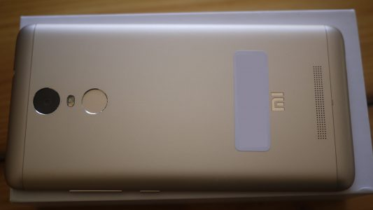 The rear camera and the fingerprint scanner which attracts all the dirt in the universe.