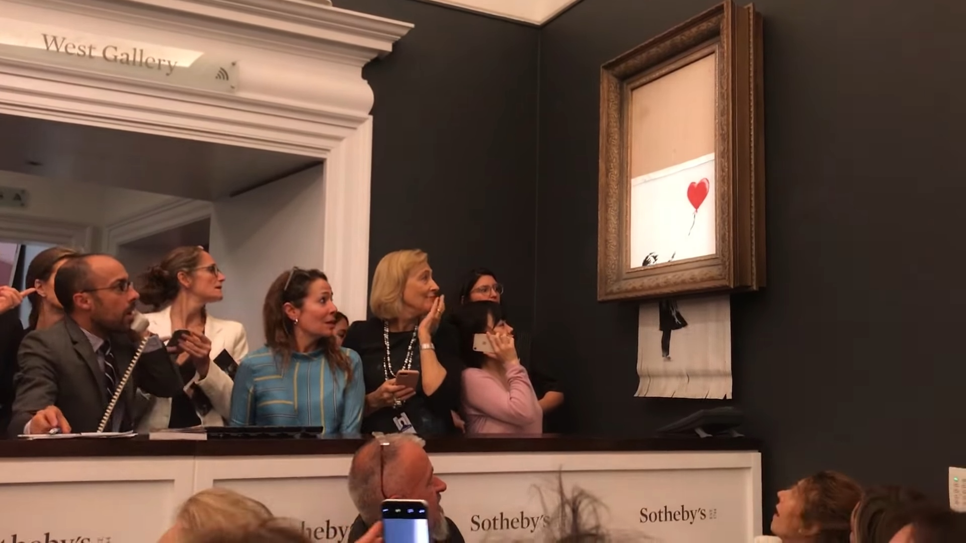 Banksy piece shreds itself after selling for record price